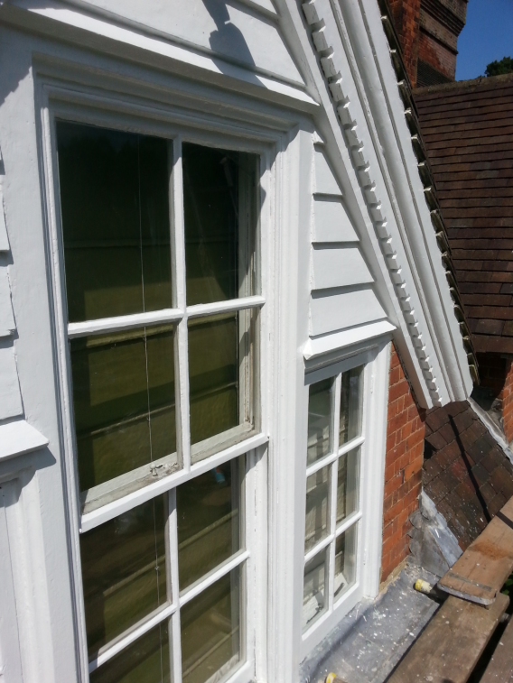 Image of grade 2 listed building wooden window renovation - after