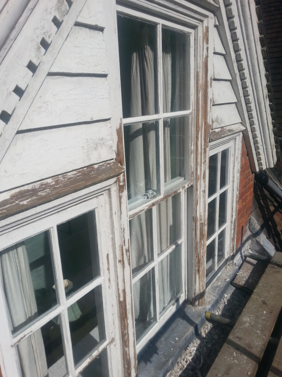 Image of grade 2 listed building wooden window renovation - before